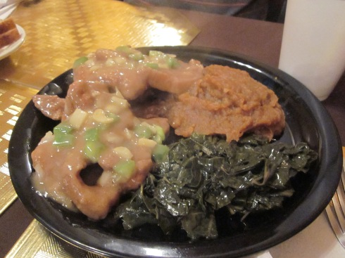 Smothered pork chops, candied yams, collard greens.