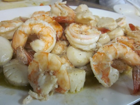 Multiple pounds of shrimp and scallops prepared scampi style.