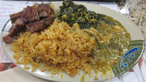 Lamb chops, spinach, okra, and jollof rice.