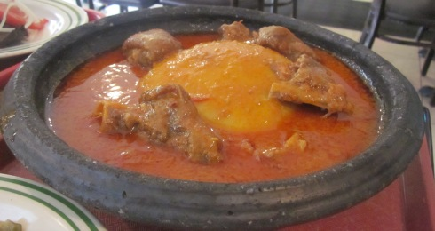 Fufu and goat meat stew