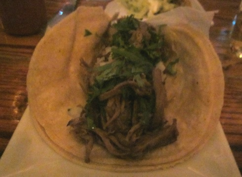 """Slowly"" roasted goat in a flour tortilla."
